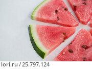 Купить «Slices of watermelon arranged on white background», фото № 25797124, снято 19 декабря 2016 г. (c) Wavebreak Media / Фотобанк Лори