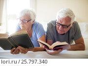 Купить «Senior couple reading books on bed», фото № 25797340, снято 29 ноября 2016 г. (c) Wavebreak Media / Фотобанк Лори