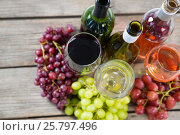 Купить «Bunches of various grapes with wine glass and bottles», фото № 25797496, снято 19 декабря 2016 г. (c) Wavebreak Media / Фотобанк Лори