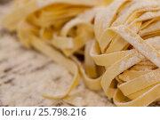 Купить «Fettuccine pasta dusted with flour», фото № 25798216, снято 13 октября 2016 г. (c) Wavebreak Media / Фотобанк Лори