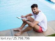 Купить «Lifeguard writing on clipboard at poolside», фото № 25798796, снято 29 ноября 2016 г. (c) Wavebreak Media / Фотобанк Лори