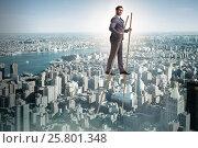 Купить «Businessman walking on stilts - standing out from the crowd», фото № 25801348, снято 23 февраля 2019 г. (c) Elnur / Фотобанк Лори