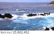 Купить «Побережье Атлантического океана у северного берега острова Мадейра. Синие океанские волны разбиваются о вулканические прибрежные камни. Морской фон», видеоролик № 25802452, снято 2 февраля 2012 г. (c) Виктория Катьянова / Фотобанк Лори