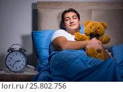 Купить «Young man sleeping in the bed», фото № 25802756, снято 28 декабря 2016 г. (c) Elnur / Фотобанк Лори