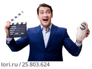 Купить «Handsome man with movie clapper isolated on white», фото № 25803624, снято 5 ноября 2016 г. (c) Elnur / Фотобанк Лори
