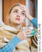 Купить «Young female having quinsy and fever and staying in couch», фото № 25804148, снято 21 апреля 2019 г. (c) Яков Филимонов / Фотобанк Лори