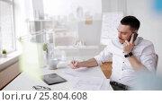 Купить «businessman with papers and smartphone at office», видеоролик № 25804608, снято 9 марта 2017 г. (c) Syda Productions / Фотобанк Лори