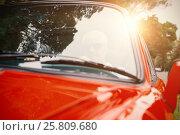 Купить «Man driving a red car», фото № 25809680, снято 22 июля 2018 г. (c) Wavebreak Media / Фотобанк Лори