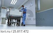Купить «Team of doctors taking patient to operation theatre», видеоролик № 25817472, снято 22 марта 2019 г. (c) Wavebreak Media / Фотобанк Лори