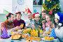 Large family eating together during festive Christmas dinner, фото № 25820096, снято 27 марта 2017 г. (c) Яков Филимонов / Фотобанк Лори