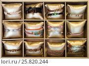 Купить «bracelets in bijouterie store», фото № 25820244, снято 19 сентября 2018 г. (c) Яков Филимонов / Фотобанк Лори