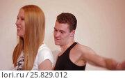 Young couple fooling and dancing like children. Стоковое видео, видеограф Илья Насакин / Фотобанк Лори