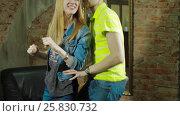 Купить «Happy and attractive young couple dance together», видеоролик № 25830732, снято 10 марта 2017 г. (c) Илья Насакин / Фотобанк Лори