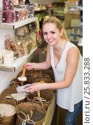 Купить «Positive young woman taking with scoop cereals», фото № 25833288, снято 24 января 2020 г. (c) Яков Филимонов / Фотобанк Лори