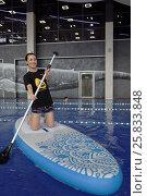 Купить «Девушка на SUP-борде производства компании Тайм Триал, Санкт-Петербург», фото № 25833848, снято 27 марта 2017 г. (c) Stockphoto / Фотобанк Лори