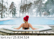 Young blonde woman in red hut in bathtub jacuzzi outdoors at winter. Стоковое фото, фотограф Алексей / Фотобанк Лори