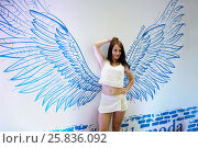 Купить «RUSSIA, MOSCOW - JUN 12, 2015: Young woman poses at Olympiysky sports complex before Sensation Wicked Wonderland show begins», фото № 25836092, снято 12 июня 2015 г. (c) Losevsky Pavel / Фотобанк Лори