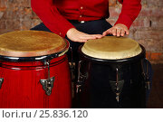 Купить «Hands of young man hit modern drums in studio with red brick wall», фото № 25836120, снято 9 февраля 2016 г. (c) Losevsky Pavel / Фотобанк Лори