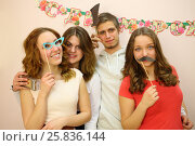 Купить «Portrait of a young man and three girls with the paper props near the wall with the inscription happy birthday», фото № 25836144, снято 7 марта 2015 г. (c) Losevsky Pavel / Фотобанк Лори