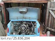Купить «MOSCOW - MAR 9, 2015: Zaporozhec, rear-passenger compact car, open hood, engine can be seen, antique Car Museum at Rogozhsky val street», фото № 25836204, снято 9 марта 2015 г. (c) Losevsky Pavel / Фотобанк Лори