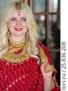 Купить «Smiling blonde woman in red dress and golden decorations», фото № 25836208, снято 17 сентября 2015 г. (c) Losevsky Pavel / Фотобанк Лори