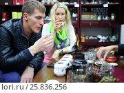Купить «Woman and man taste Chinese tea and sniff tea during tea ceremony», фото № 25836256, снято 6 ноября 2015 г. (c) Losevsky Pavel / Фотобанк Лори