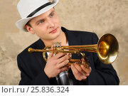 Купить «Young handsome man in white hat and jacket poses with trumpet in studio», фото № 25836324, снято 9 февраля 2016 г. (c) Losevsky Pavel / Фотобанк Лори