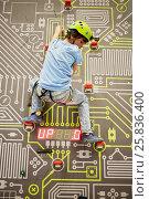 Купить «Teenage boy in equipment climbs on climbing wall», фото № 25836400, снято 12 декабря 2014 г. (c) Losevsky Pavel / Фотобанк Лори