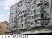 Купить «Balconies with laundry dryer and windows of big residential building in sleeping area», фото № 25836588, снято 7 ноября 2015 г. (c) Losevsky Pavel / Фотобанк Лори