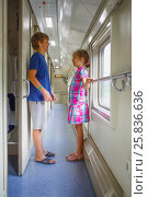 Купить «Brother and sister standing in corridor train compartment and laughing», фото № 25836636, снято 5 августа 2014 г. (c) Losevsky Pavel / Фотобанк Лори