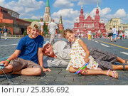 Купить «Grandfather with grandson and granddaughter sit on red square», фото № 25836692, снято 6 августа 2014 г. (c) Losevsky Pavel / Фотобанк Лори