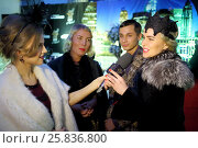 Купить «MOSCOW - APR 26, 2015: Guests give interviews at a party in honor of the birthday the glossy magazine LF city in karaoke club Chicago», фото № 25836800, снято 26 апреля 2015 г. (c) Losevsky Pavel / Фотобанк Лори