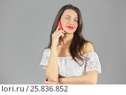 Купить «Half-length portrait of woman in white dress talking on phone, looking throw, on gray background», фото № 25836852, снято 14 декабря 2014 г. (c) Losevsky Pavel / Фотобанк Лори