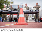 Купить «MOSCOW, RUSSIA - AUG 20, 2016: Red protective cone and firefighters team at background during the Moscow City Championship of combat deployment in Luzhniki», фото № 25836868, снято 20 августа 2016 г. (c) Losevsky Pavel / Фотобанк Лори