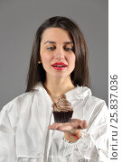 Купить «Half-length portrait of woman holding piece of tasty chocolate cake and looks with desire to eat this cake, on gray background», фото № 25837036, снято 14 декабря 2014 г. (c) Losevsky Pavel / Фотобанк Лори