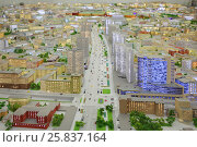 MOSCOW - DEC 20, 2014: Miniature of New arbat street in Moscow with illumination in VDNKH exhibition. Редакционное фото, фотограф Losevsky Pavel / Фотобанк Лори