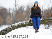 Купить «Girl teenager sits on thick branch of tree and smiles in winter day», фото № 25837264, снято 31 января 2015 г. (c) Losevsky Pavel / Фотобанк Лори