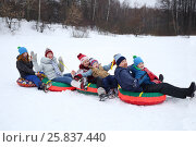 Купить «Six happy people sits on four snow tubes in snow winter day», фото № 25837440, снято 31 января 2015 г. (c) Losevsky Pavel / Фотобанк Лори
