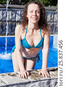 Купить «Young woman with curly hair in swimsuit stands leaning her hands on edge of pool», фото № 25837456, снято 23 июня 2015 г. (c) Losevsky Pavel / Фотобанк Лори