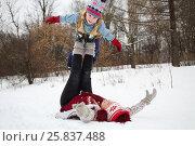 Купить «Woman lies on her back and holds little cute boy on feet in snow», фото № 25837488, снято 31 января 2015 г. (c) Losevsky Pavel / Фотобанк Лори