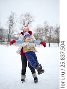 Купить «Happy woman circles her little handsome son at snowy winter day», фото № 25837504, снято 31 января 2015 г. (c) Losevsky Pavel / Фотобанк Лори