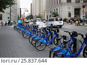 Купить «NEW YORK, USA - SEP 08, 2014:  Several blue bicycle in hire at the intersection of Central street and Worth street», фото № 25837644, снято 8 сентября 2014 г. (c) Losevsky Pavel / Фотобанк Лори