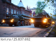 Купить «SAMARA, RUSSIA - MAY 6, 2015: Two rows of trucks with rocket launchers on streets of Samara at dusk on military celebration. President satisfied with Victory Day, if sincere people are happy - thats good», фото № 25837692, снято 6 мая 2015 г. (c) Losevsky Pavel / Фотобанк Лори