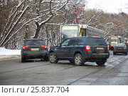 Купить «Car accident on city road with tramways at winter day in Moscow, Russia», фото № 25837704, снято 6 февраля 2015 г. (c) Losevsky Pavel / Фотобанк Лори