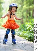 Купить «Little happy girl in skirt and helmet roller skates in garden at summer day», фото № 25837812, снято 24 июня 2015 г. (c) Losevsky Pavel / Фотобанк Лори