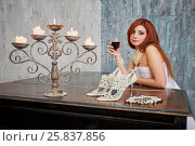 Купить «Red-haired woman in white dress stands leaning her elbows on grand piano lid with glass of red wine», фото № 25837856, снято 12 февраля 2015 г. (c) Losevsky Pavel / Фотобанк Лори