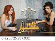 Купить «Red-haired woman in white dress and dark-haired woman in black dress play chess on the old grand piano lid in room with ragged walls», фото № 25837932, снято 12 февраля 2015 г. (c) Losevsky Pavel / Фотобанк Лори