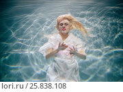 Купить «Young blond woman in white dress swims with her eyes close in swimming pool underwater», фото № 25838108, снято 14 мая 2016 г. (c) Losevsky Pavel / Фотобанк Лори