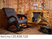 Купить «Rocking-chair and gramophone near fireplace in room with wooden walls and floor», фото № 25838120, снято 21 мая 2015 г. (c) Losevsky Pavel / Фотобанк Лори