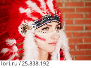 Купить «Closeup portrait of young woman dressed in hat made of red and white feathers», фото № 25838192, снято 13 февраля 2015 г. (c) Losevsky Pavel / Фотобанк Лори